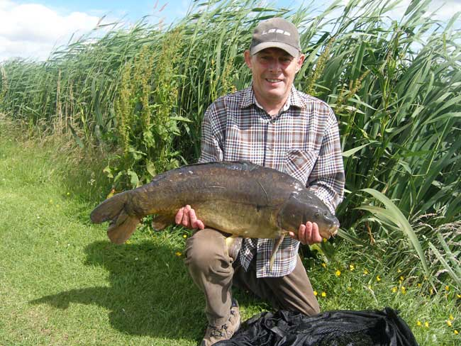 Bruce Turnbull with a 21lb 8oz Mirror Carp